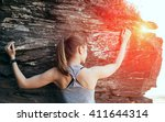 Young Woman Climbing The Rock....