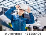 woman wearing virtual reality... | Shutterstock . vector #411666406