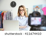young female blogger with... | Shutterstock . vector #411674410