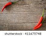 red hot chili peppers on old... | Shutterstock . vector #411675748