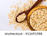 rolled oats  oat flakes  in a... | Shutterstock . vector #411691588