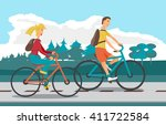 young woman and man ride bike... | Shutterstock . vector #411722584