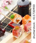 japanese cuisine. sushi set and ... | Shutterstock . vector #411730900