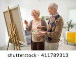 elderly couple having fun... | Shutterstock . vector #411789313