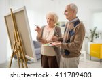 senior couple drawing together... | Shutterstock . vector #411789403