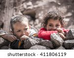Small photo of IMLIL - 9th of April, 2016: Berber kids in the village in High Atlas Mountains of Morocco