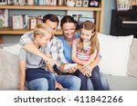 happy family using mobile phone ... | Shutterstock . vector #411842266