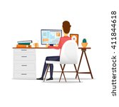 man sitting at a desk and... | Shutterstock .eps vector #411844618