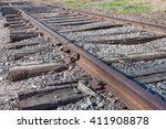 Old railroad tracks with wooden ties and gravel - stock photo