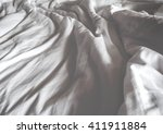 messy white bed and two pillow  ... | Shutterstock . vector #411911884
