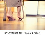young woman being walking on... | Shutterstock . vector #411917014