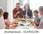 family sitting at dining table... | Shutterstock . vector #411931198
