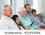 happy family sitting on sofa... | Shutterstock . vector #411933406