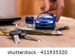 toy car in hand  keys and money ... | Shutterstock . vector #411935320