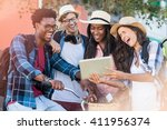 group of friends using digital... | Shutterstock . vector #411956374