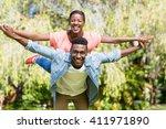 happy family having fun at park | Shutterstock . vector #411971890
