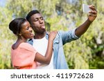 happy family taking a photo at... | Shutterstock . vector #411972628