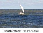 yacht in stormy seas. | Shutterstock . vector #411978553