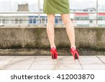 woman's legs  in red high heel... | Shutterstock . vector #412003870