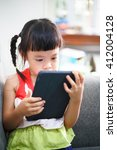 asian little girl playing on a... | Shutterstock . vector #412004128