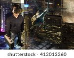 a person wears virtual reality... | Shutterstock . vector #412013260
