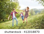 photo of a young family... | Shutterstock . vector #412018870