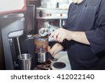 barman hold bottle and pouring... | Shutterstock . vector #412022140