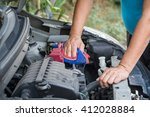 Small photo of A car mechanic replaces a battery. battery. battery. battery. battery. battery. battery. battery. battery. battery. battery. battery. battery. battery. battery. battery. battery. battery.