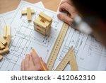 mechanical engineer at work.... | Shutterstock . vector #412062310