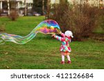 the child in park a outdoors... | Shutterstock . vector #412126684