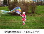 the child in park a outdoors... | Shutterstock . vector #412126744