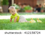 Baby Boy Crawling On Green...