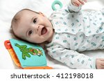cute smiling infant lying in... | Shutterstock . vector #412198018