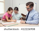 Young Teacher And Two...