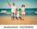 happy family having fun on the... | Shutterstock . vector #412332844