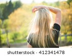 blonde woman posing outdoor at... | Shutterstock . vector #412341478