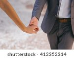 loving couple holding hands... | Shutterstock . vector #412352314