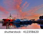 reflection of boats and clouds... | Shutterstock . vector #412358620