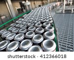 Small photo of Stain-roof jars with drinks on the assembly line. for the production of alcoholic and soft drinks line. The final stage in the manufacture of the product.