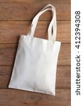 White Fabric Bag On Wooden...