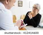 woman looking at male doctor...   Shutterstock . vector #412414600