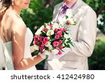 groom and bride holding in her... | Shutterstock . vector #412424980