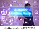 Small photo of Customer Lifetime Value (CLV) concept presented by businessman touching on virtual screen ,image element furnished by NASA