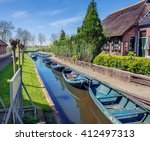 boats in spring in giethoorn  a ... | Shutterstock . vector #412497313