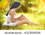 The Girl Sits On A Forest Glad...