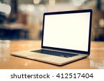 laptop with blank screen on... | Shutterstock . vector #412517404