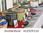 row of crock pots for chili... | Shutterstock . vector #412529113