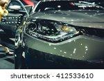 headlight of a modern luxury... | Shutterstock . vector #412533610