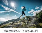 female running in mountains... | Shutterstock . vector #412660054