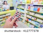 pharmacist holding medicine...   Shutterstock . vector #412777378